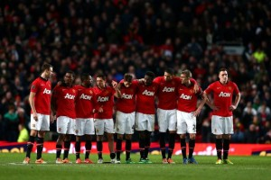 hi-res-464519829-manchester-united-players-huddle-whilst-the-penalty_crop_north